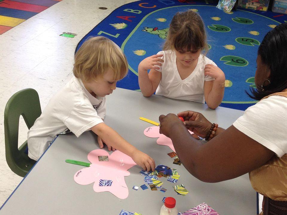 children doing art with teacher at a Preschool & Daycare Serving Greenville, AL