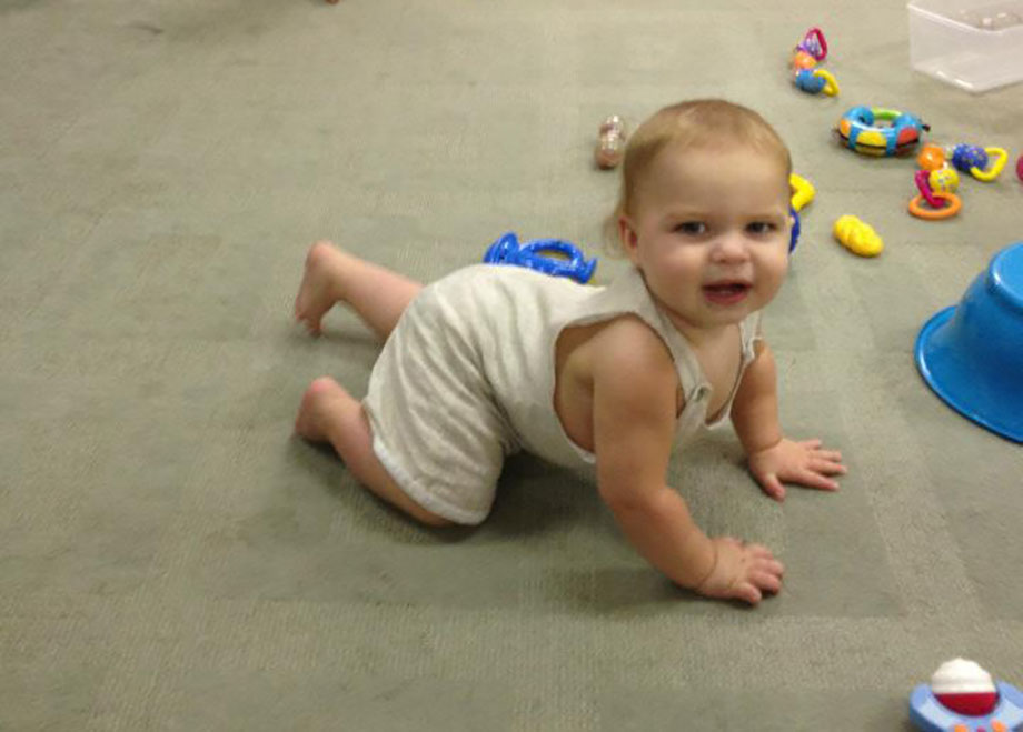 cute baby crawling at a Preschool & Daycare Serving Greenville, AL