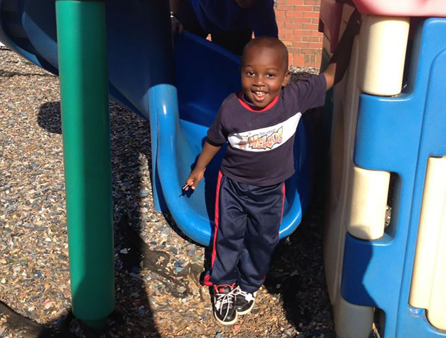 happy smiling boy in playground at a Preschool & Daycare Serving Greenville, AL