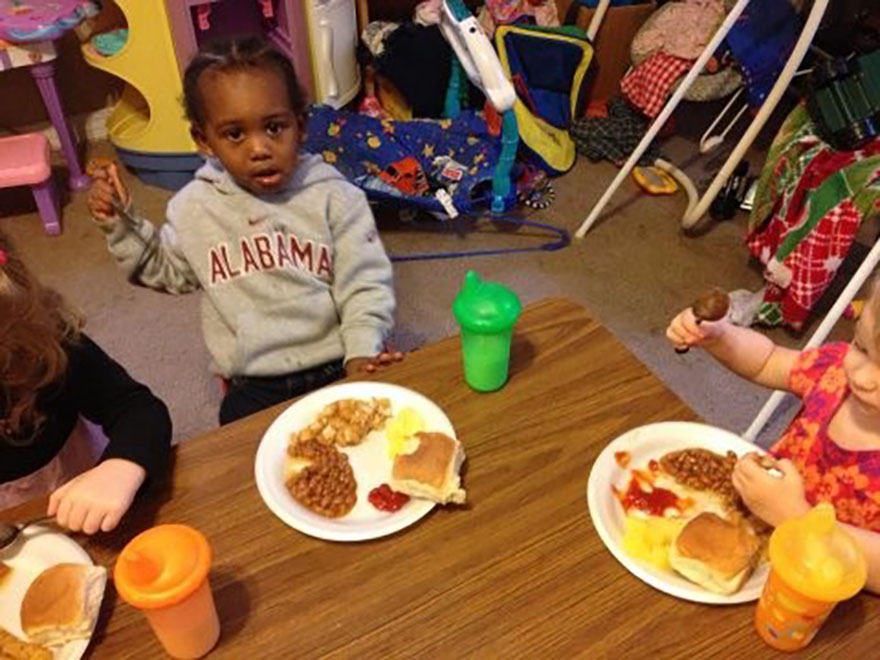 happy toddler eating at a Preschool & Daycare Serving Greenville, AL