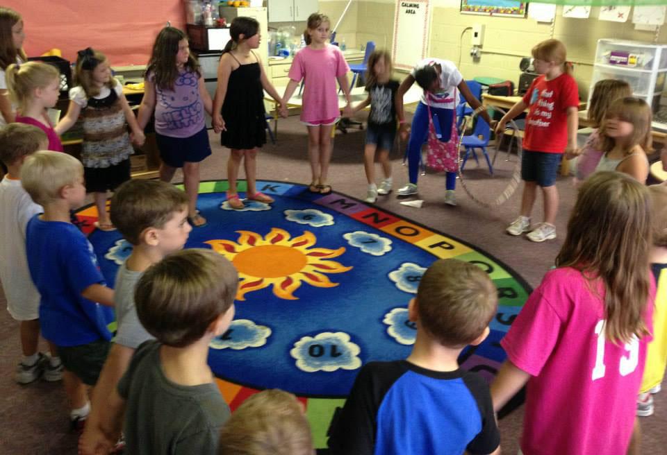 pre k children holding hands at a Preschool & Daycare Serving Greenville, AL