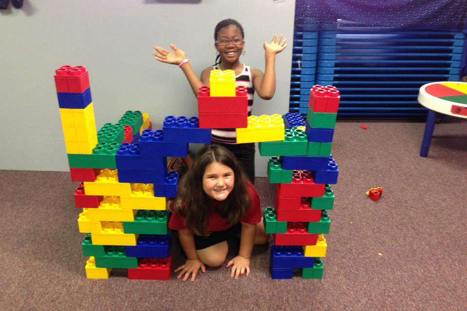 two happy girls playing with legos at a Preschool & Daycare Serving Greenville, AL