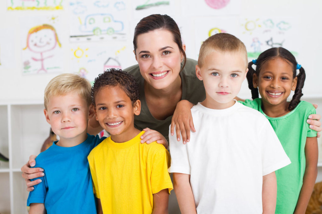 Career young teacher and kindergarten students - Serving Greenville, AL